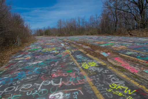 ow covered with soil to deter visitors an abandoned 25mile section oute 61 commonly known as graffiti highway displays thermal cracking and subsidence which is a direct result of mine fires below the town of entralia