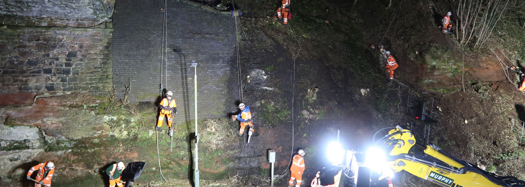 Abseiling rail workers keep passengers on the move